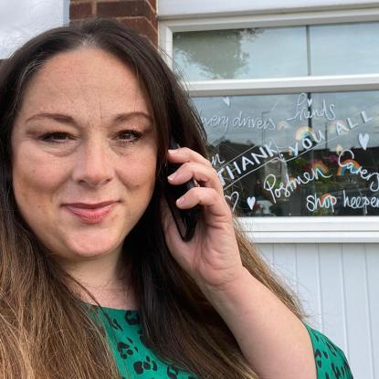 Alison is pictured on the phone speaking to a customer