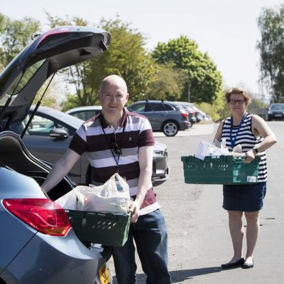 Gavin McAlister, Community Engagement Advisor at SARH, loads up his car before setting off on another delivery with Church Centre Manager Karen Wardell in the background.